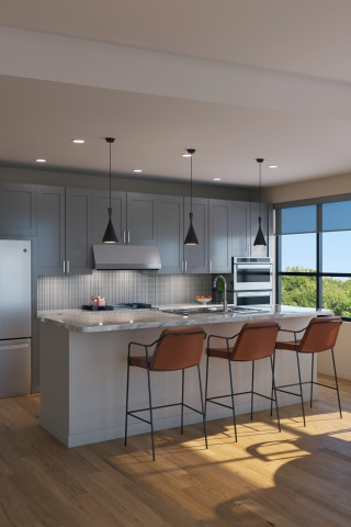 The Westcott kitchen with a dark color scheme and tan bar stools