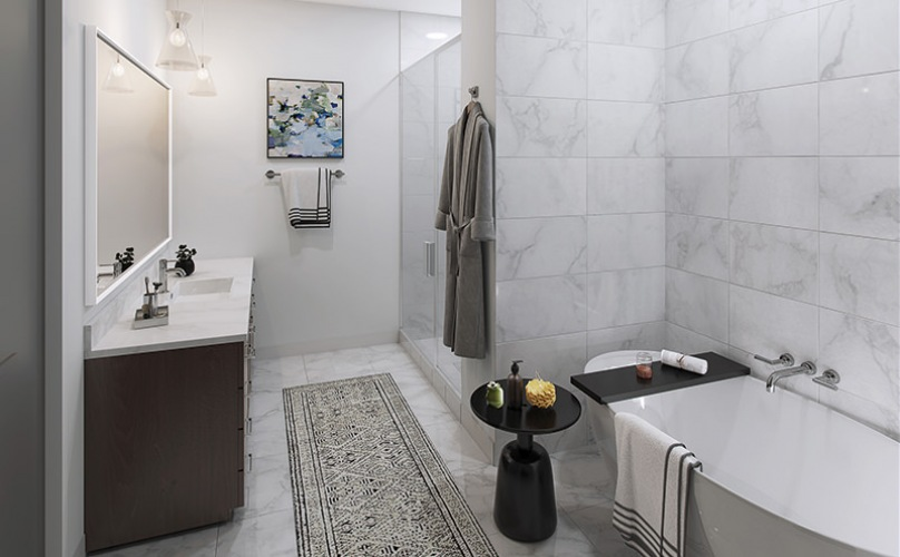 Luxury bathroom with a tub and double sink vanity